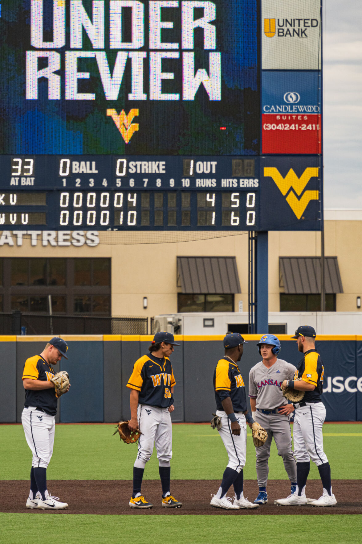 West Virginia's players wait while a play is being reviewed against Kansas on March 27, 2021, Morgantown, W.Va.