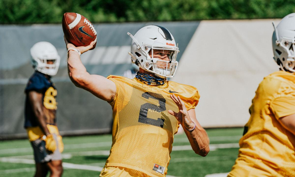 WVU quarterback Jarret Doege attempts a pass during a fall practice.