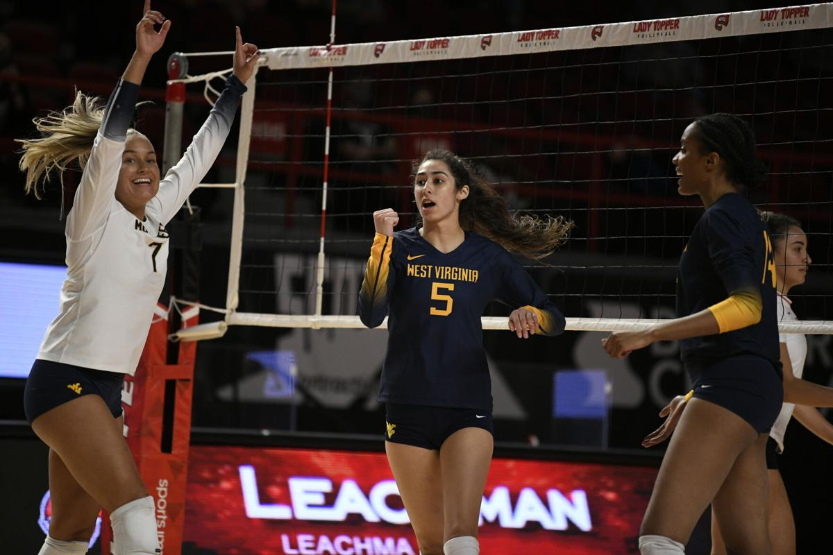 West Virginia's Athena Ardila celebrates following a point by the Mountaineers.