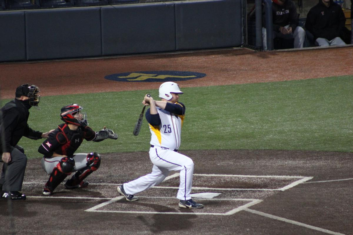 Sophomore infielder Matt McCormick takes a swing during West Virginia's game against Texas Tech on April 16, 2021, in Morgantown.