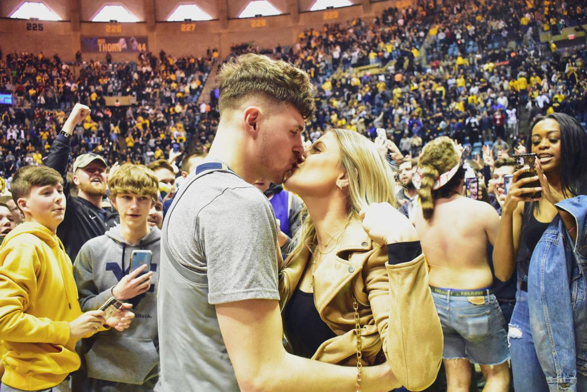 Mar. 7, 2020 - Senior Chase Harler shares a kiss with his new fiancee as fans rush the court after the win against Baylor at the Coliseum