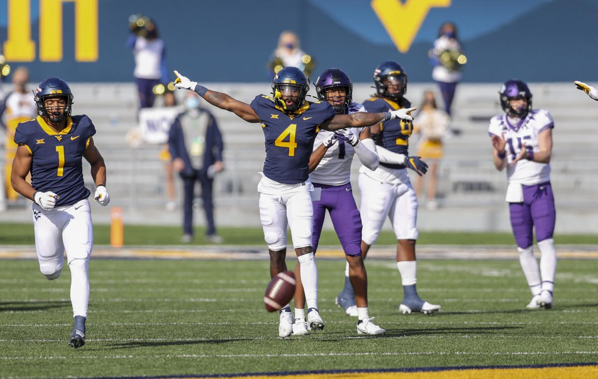 Nov 14, 2020; Morgantown, West Virginia, USA; West Virginia Mountaineers cornerback Alonzo Addae (4) celebrates after a defensive stop during the first quarter against the TCU Horned Frogs at Mountaineer Field at Milan Puskar Stadium.
