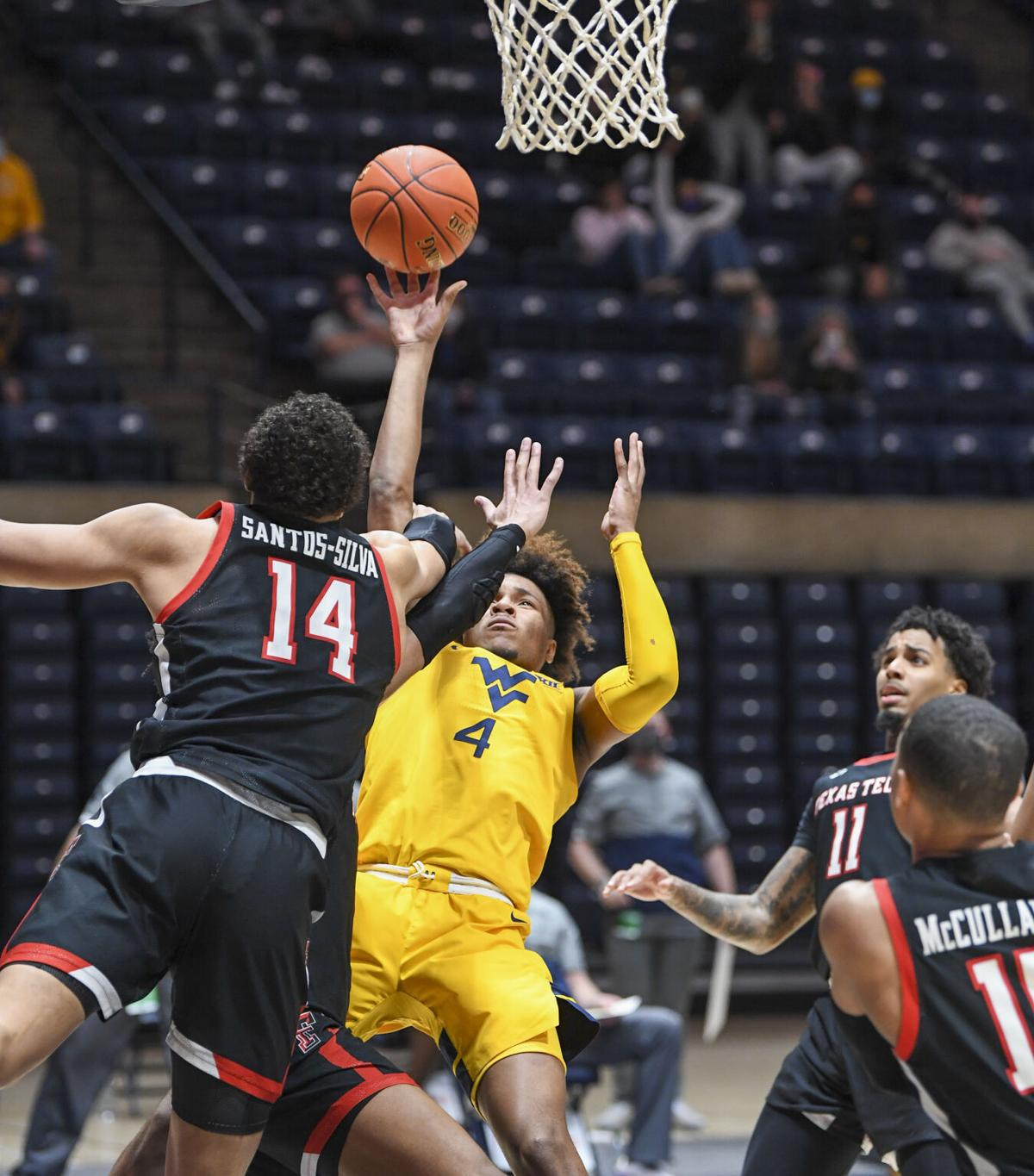 West Virginia guard Miles McBride (4) hits the game-winning basket in the final seconds against Texas Tech at the WVU Coliseum in Morgantown, W.Va., on Jan. 25, 2021.