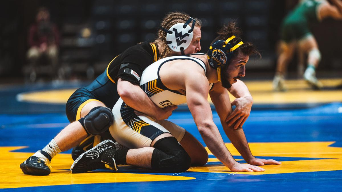 West Virginia wrestler Killian Cardinale locks up with a Kent State wrestler in WVU's matchup against the Golden Eagles at the WVU Coliseum in Morgantown, W.Va., on Jan. 10, 2021