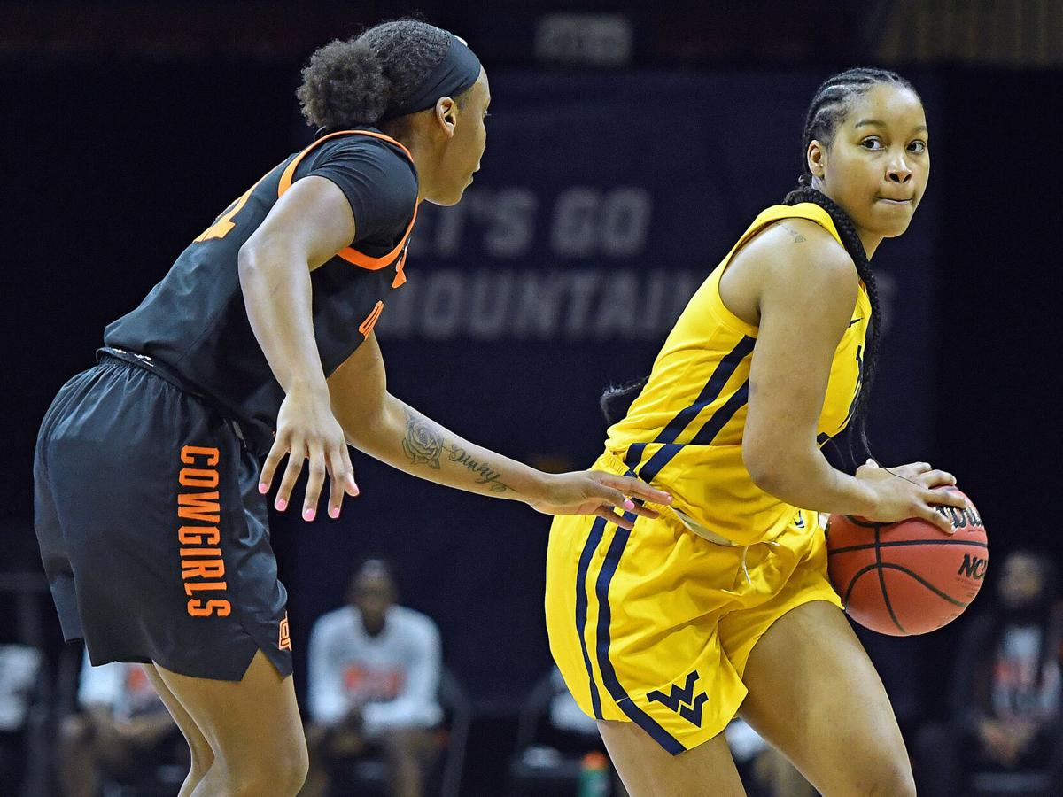WVU guard Kirsten Deans drives against the Oklahoma State Cowgirls in the Big 12 Tournament semifinal round in Kansas City, Missouri, on March 13, 2021.