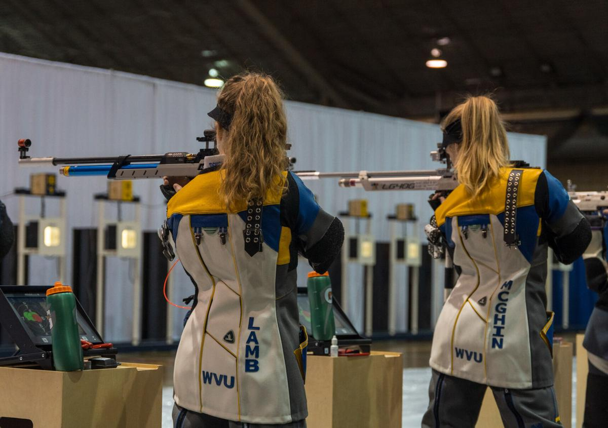 Two West Virginia Mountaineers compete in the WVU rifle quad-match on Jan. 30, 2021.