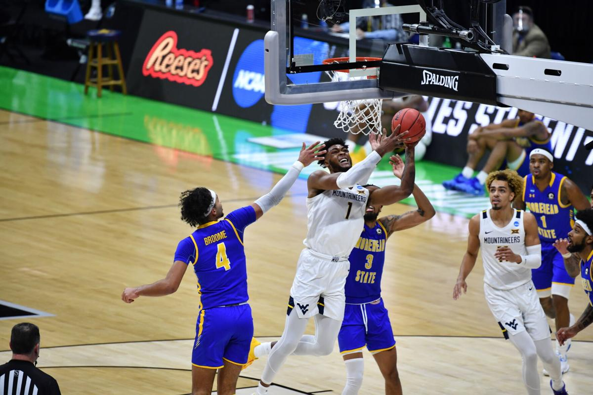 West Virginia forward Derek Culver (1) attacks the rim against Morehead State in the first round of the NCAA Tournament on March 19, 2021, in Indianapolis, Indiana.