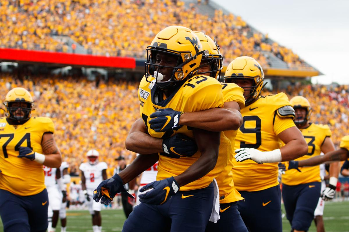West Virginia's Sam James and Randy Fields Jr. celebrate a touchdown Saturday against NC State.