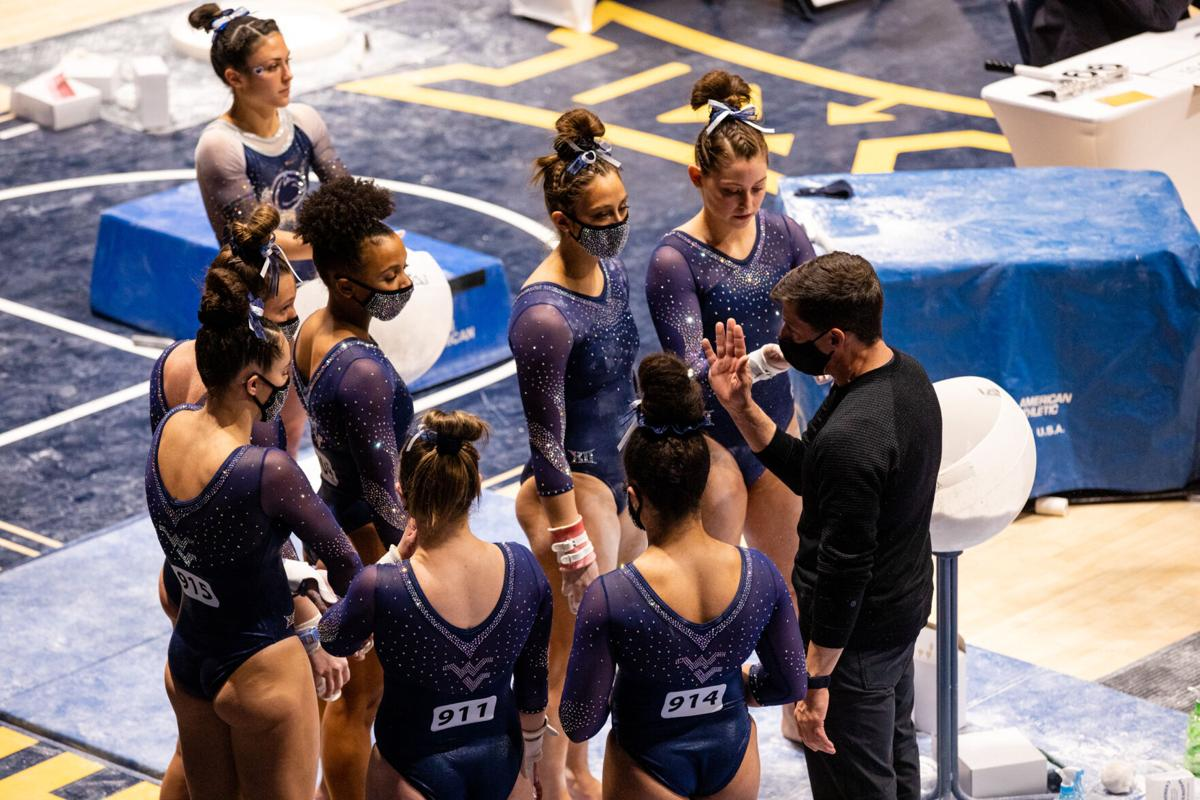 West Virginia gymnastics coach Jason Butts addresses his team during the second round of the NCAA Regionals on April 2, 2021, at the WVU Coliseum.