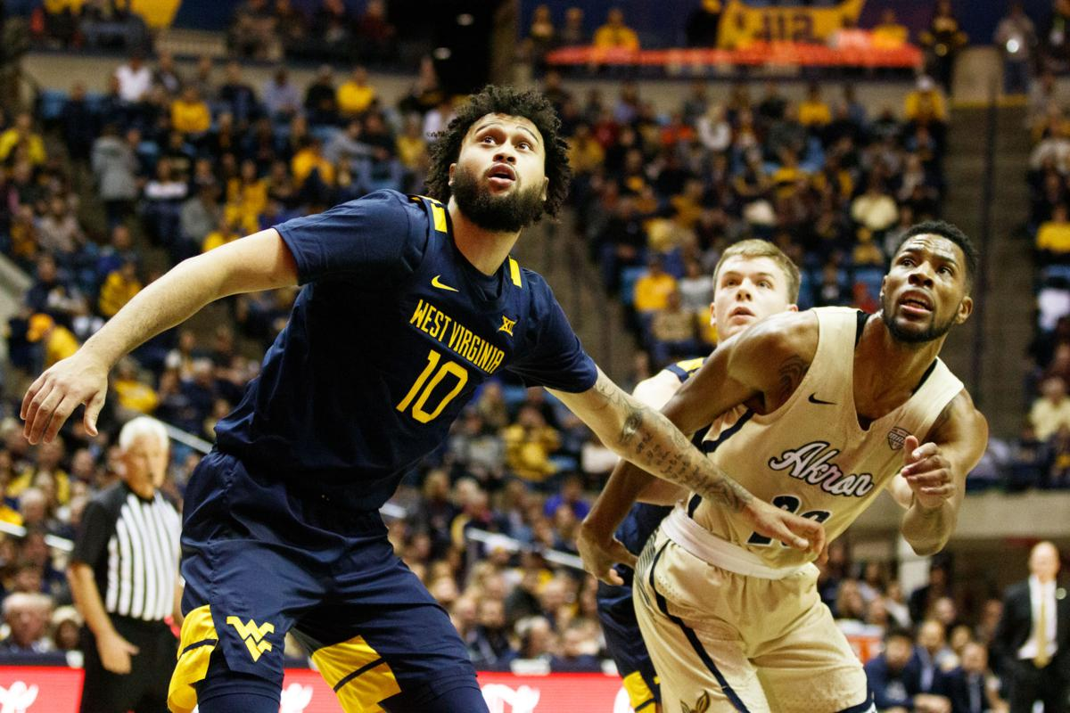 West Virginia's Jermaine Haley and Akron's Xeyrius Williams fight for a loose rebound during West Virginia's season opener against Akron on Nov. 8, 2019 at the WVU Coliseum.