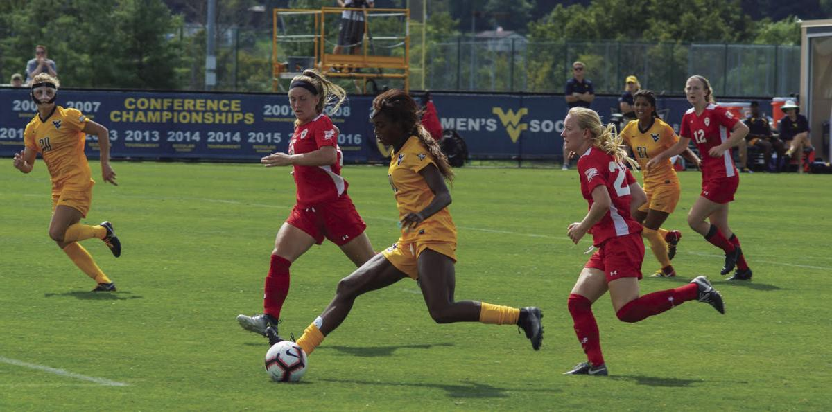 Sh'Nia Gordon charges toward the goal during WVU and St. Francis Women's Soccer.
