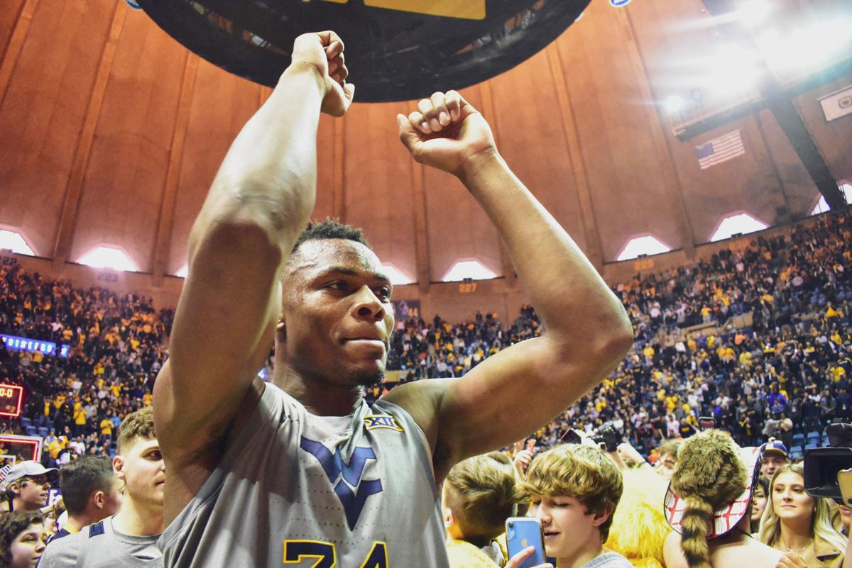 Mar. 7, 2020 - Freshman Oscar Tshiebwe raises his hands high as Mountaineers storm the court against Baylor