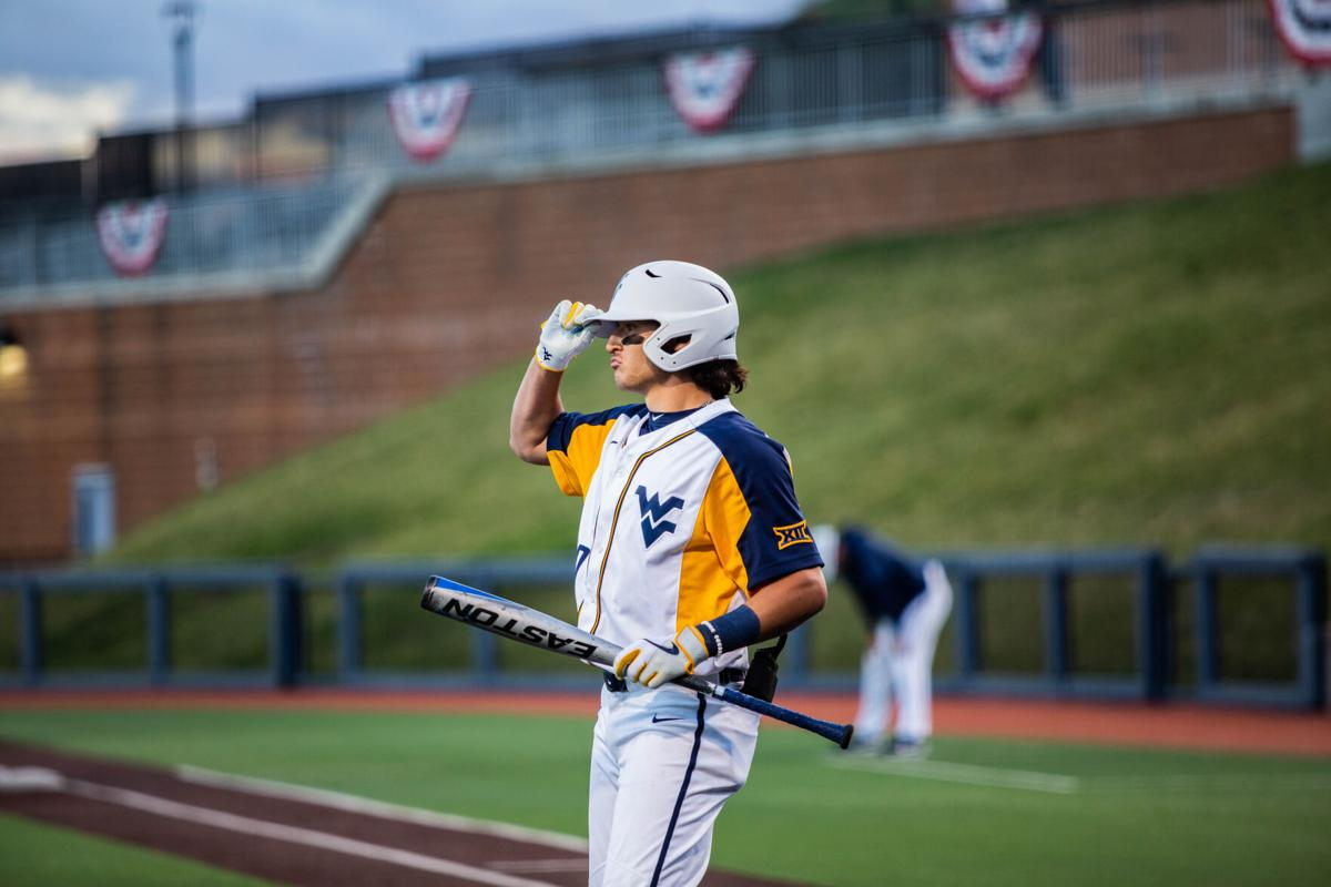 Mikey Kluska steps into the batters box during a game versus Kansas from the Monongalia County Ballpark in Morgantown W.Va., on March 26 2021.