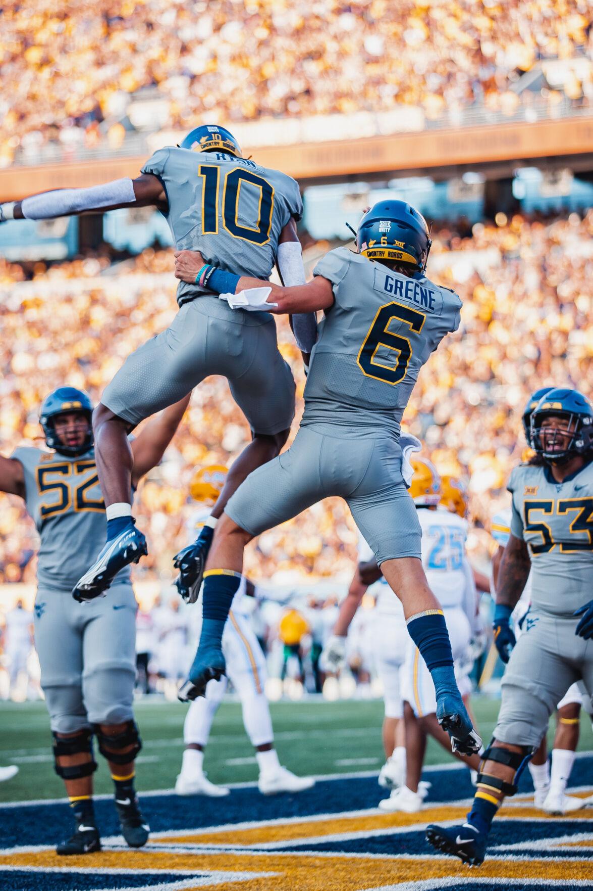 West Virginia quarterback Garrett Greene (6) and wide receiver Sean Ryan (10) celebrate following a touchdown against Long Island at Milan Puskar Stadium in Morgantown, W.Va., on Sept. 11, 2021.