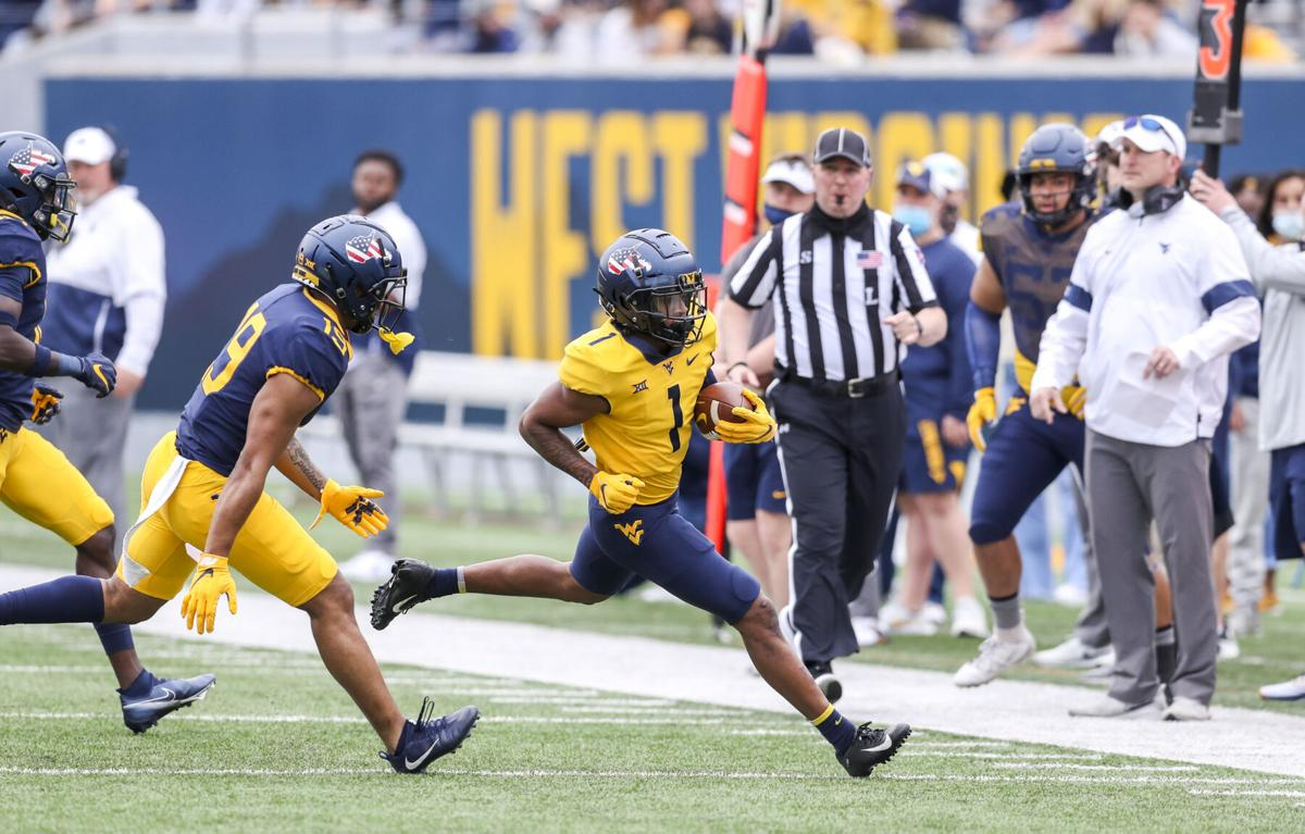 West Virginia Mountaineers wide receiver Winston Wright (1) runs after a catch during the Spring Game at Milan Puskar Stadium on April 24, 2021.