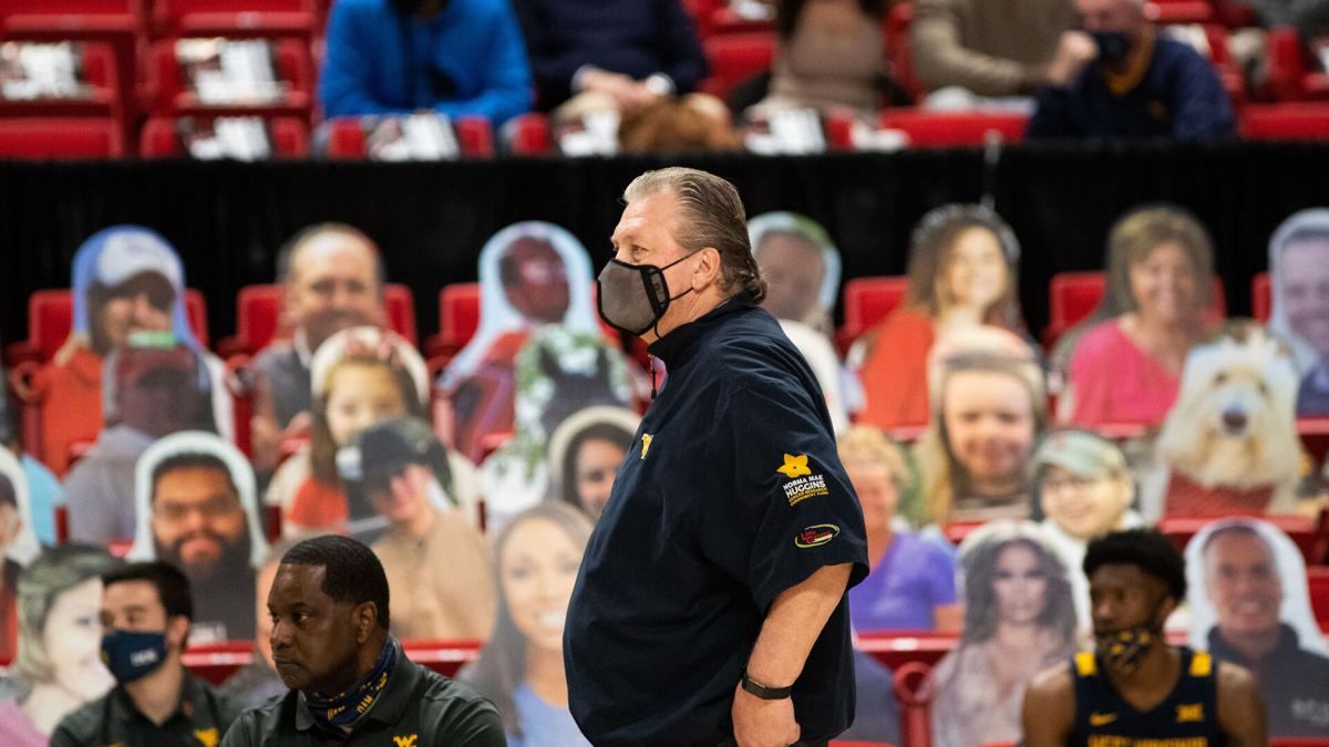 West Virginia head coach Bob Huggins looks on as the Mountaineers face Texas Tech in Lubbock, Texas, on Feb. 9, 2021.