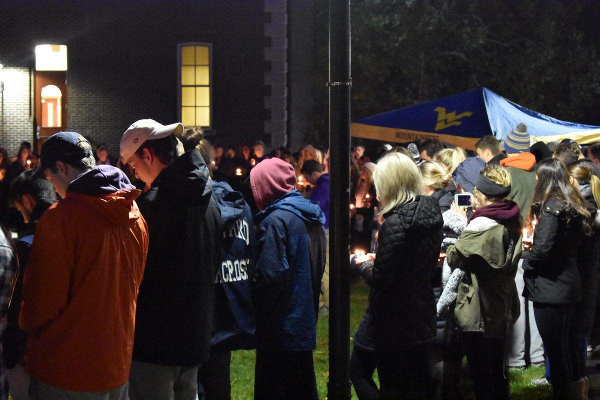 David Rusko gather in Woodburn Circle during a prayer vigil held on Nov. 12, 2018
