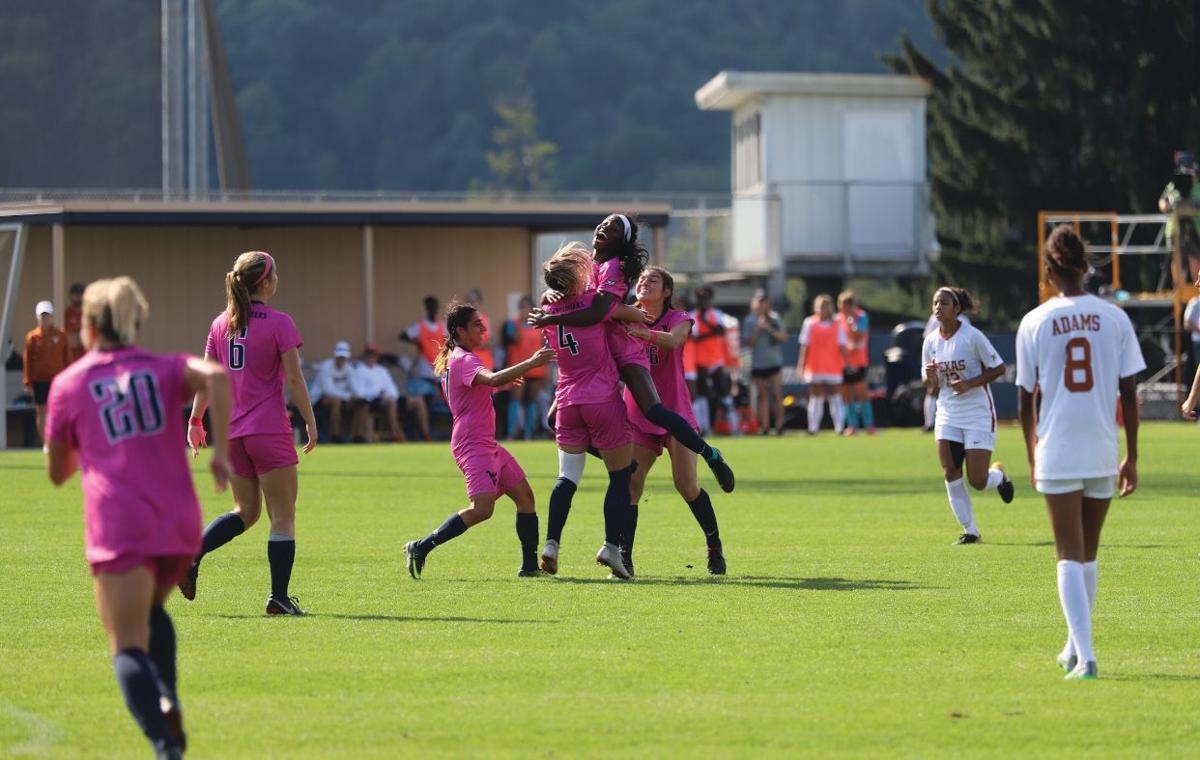 Nadya Gill, Bianca St. Georges, Easther Mayi Kith and Vanessa Flores celebrates after St. Georges scored a goal.
