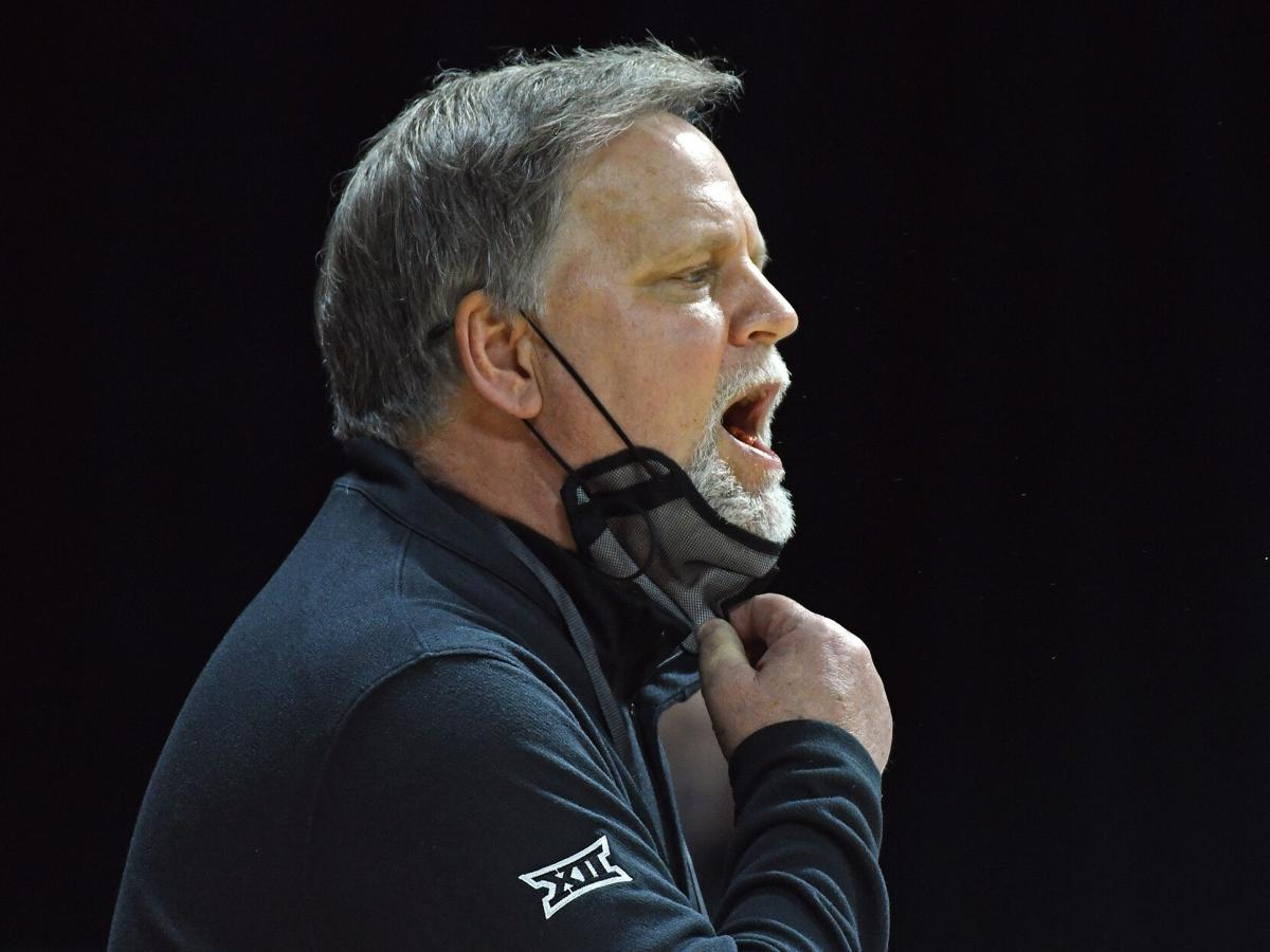 West Virginia head coach Mike Carey yells out instructions to his team during West Virginia's game against Kansas State in the quarterfinal round of the Big 12 Tournament in Kansas City, Missouri, on March 12, 2021.