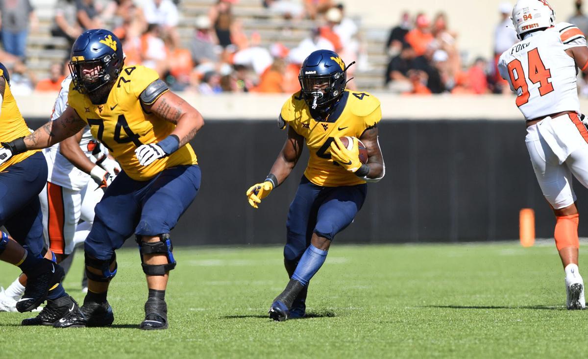 West Virginia running back Leddie Brown runs the ball against Oklahoma State.