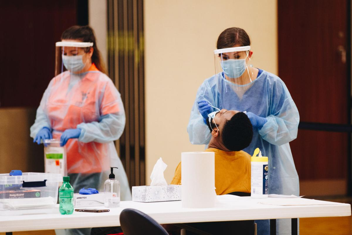 A WVU student is administered a COVID-19 test by University personnel in the Mountainlair ballrooms on August 21.