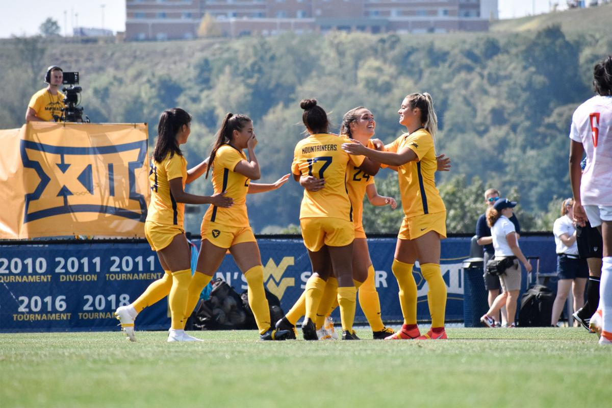 Members of the WVU women's soccer team come together after Alina Stahl scores against Bowling Green.