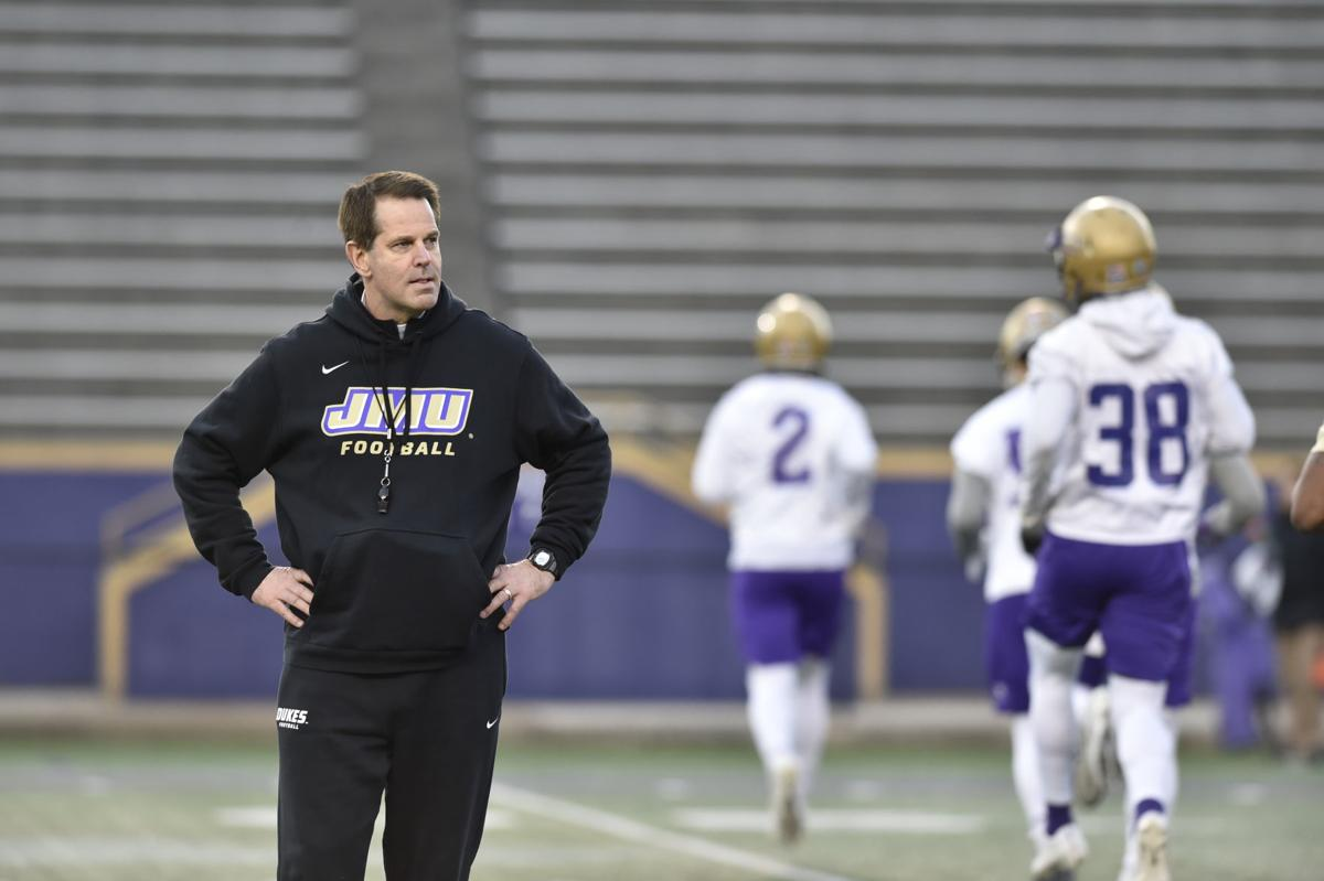Jame Madison head coach Curt Cignetti looks off into the distance during a practice.