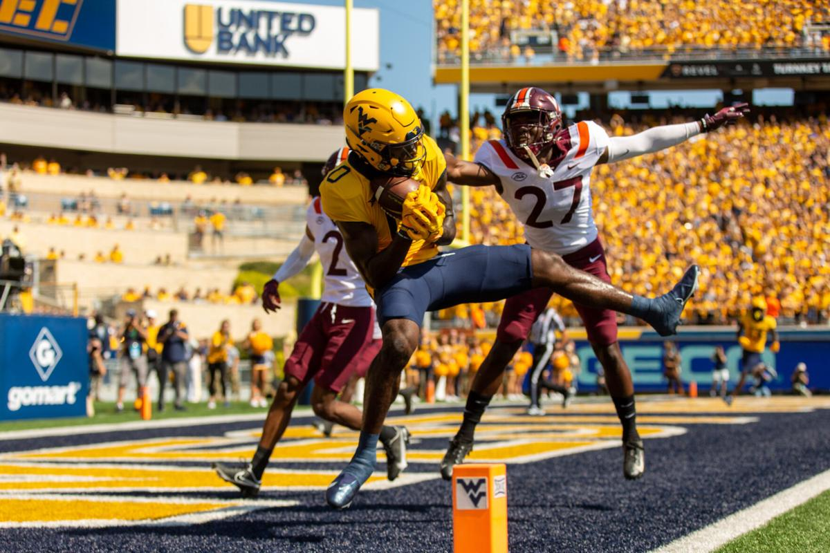 Bryce Ford-Wheaton (0) catches a 16-yard touchdown from Jarrett Doege to double WVU's lead in the first half against Virginia Tech in Morgantown, W.Va., on Sept. 18, 2021.
