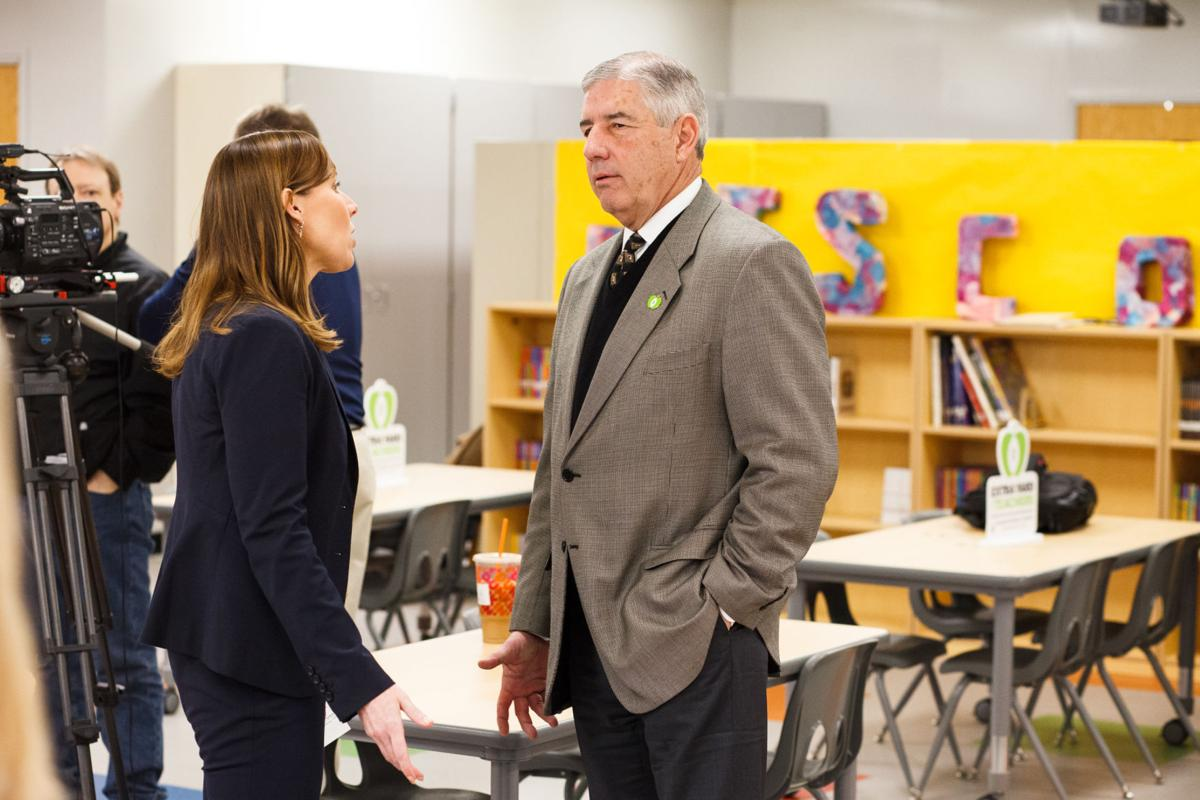 Bob Bowlsby, Big 12 Commissioner, speaks with Keli Zinn, West Virginia University Deputy Director of Athletics, at the unveiling of a library make-over by the College Football Playoff Foundation and the Big 12 Conference at Mountain View Elementary School in Morgantown, WV on Feb. 24, 2020.
