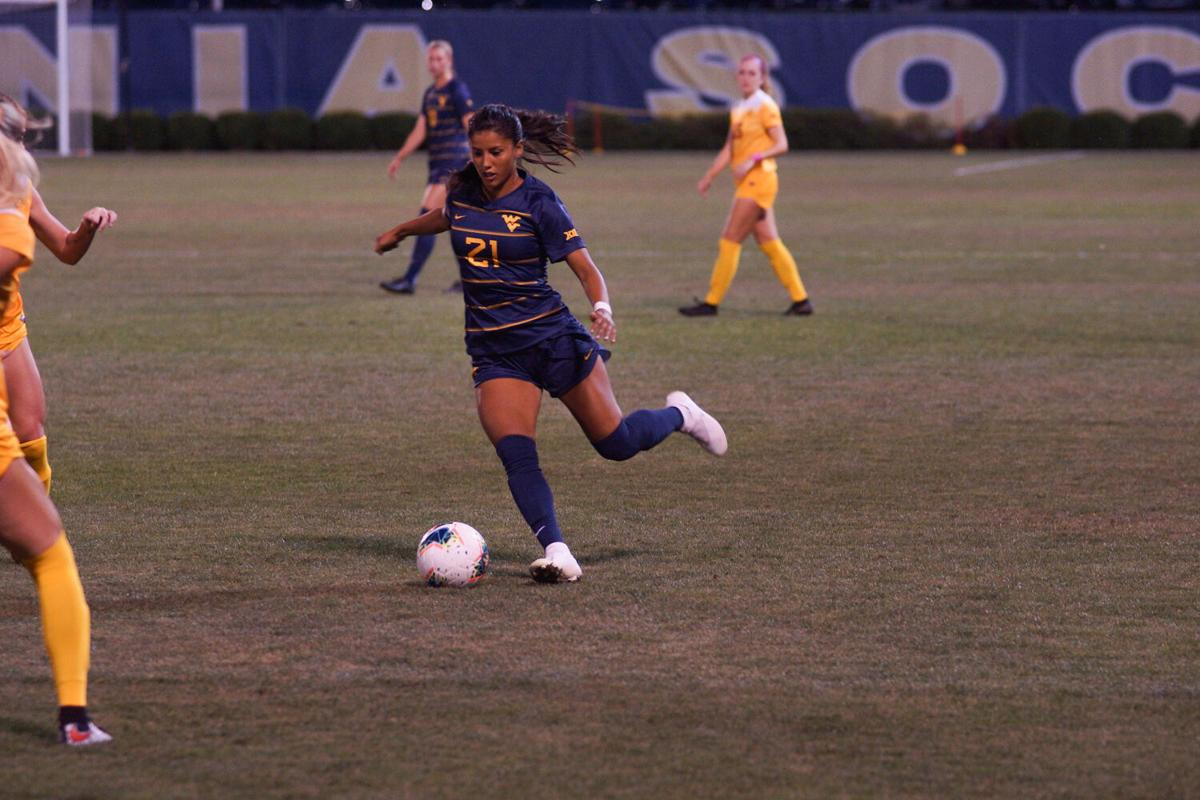 Stefany Ferrer-Vanginkel passes the ball to a fellow teammate.
