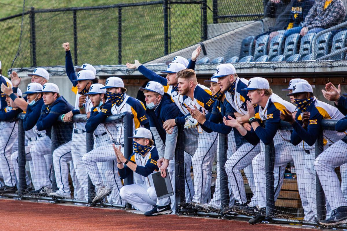 The West Virginia baseball team watches from the dugout during a win over Kansas at the Monongalia County Ballpark on March 26, 2021.