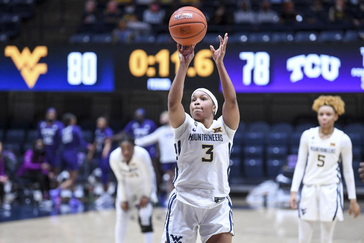 West Virginia guard Kirsten Deans (3) attempts a free throw against TCU at the WVU Coliseum in Morgantown, W.Va.,  on Feb. 20 2021