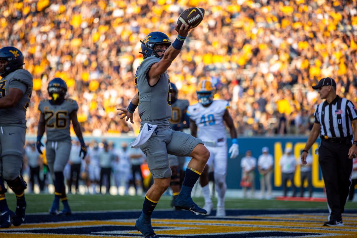 West Virginia quarterback Garrett Greene celebrates after scoring a rushing touchdown against Long Island at Milan Puskar Stadium in Morgantown, W.Va., on Sept. 11, 2021.