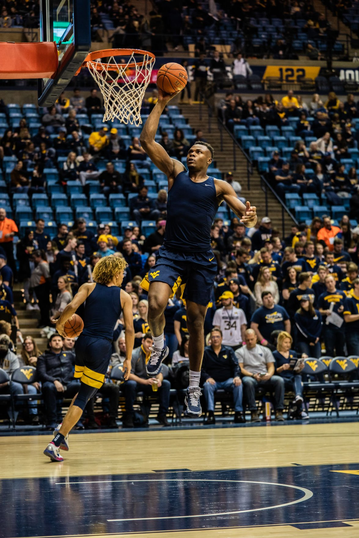Oscar Tshiebwe goes up for a dunk during warm ups before taking on Kansas State at the WVU Coliseum on Feb. 1, 2020.