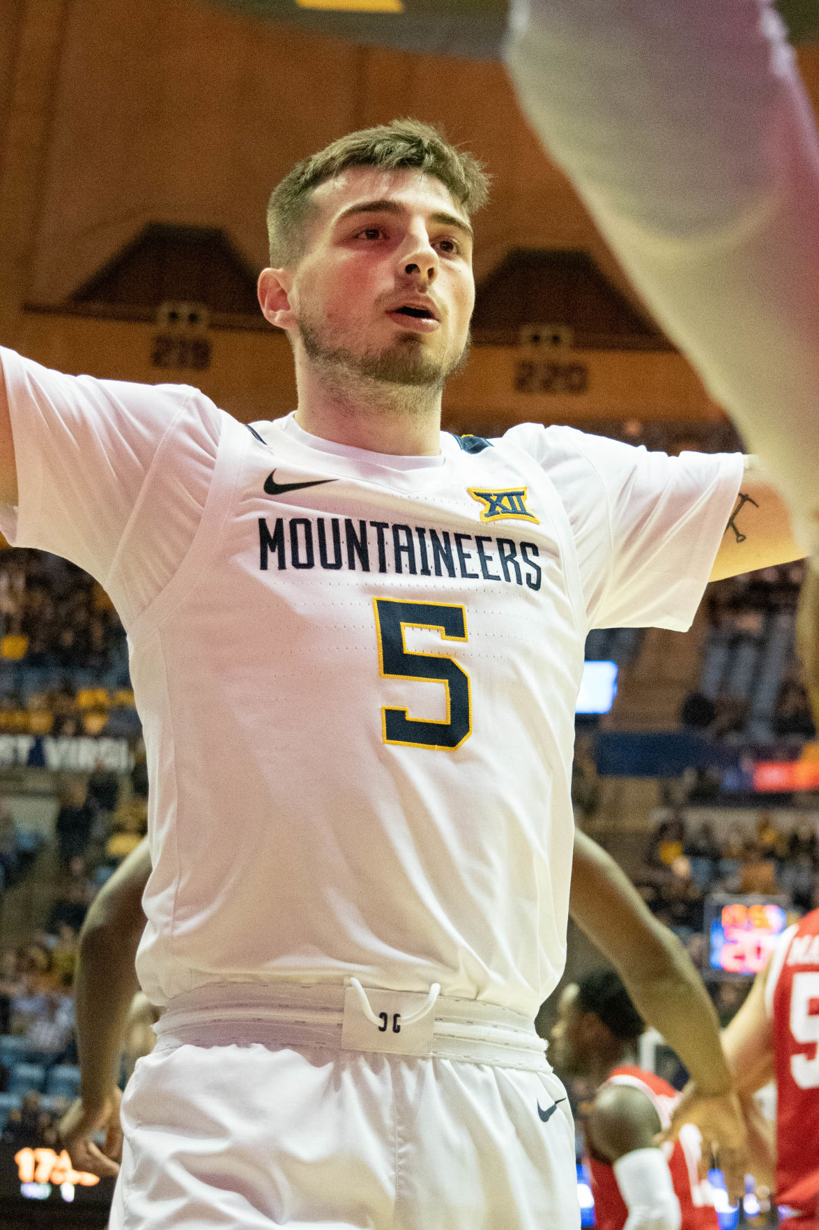 WVU guard Jordan McCabe defends against a Boston inbound pass against the Terriers at the WVU Coliseum on Nov. 22, 2019.
