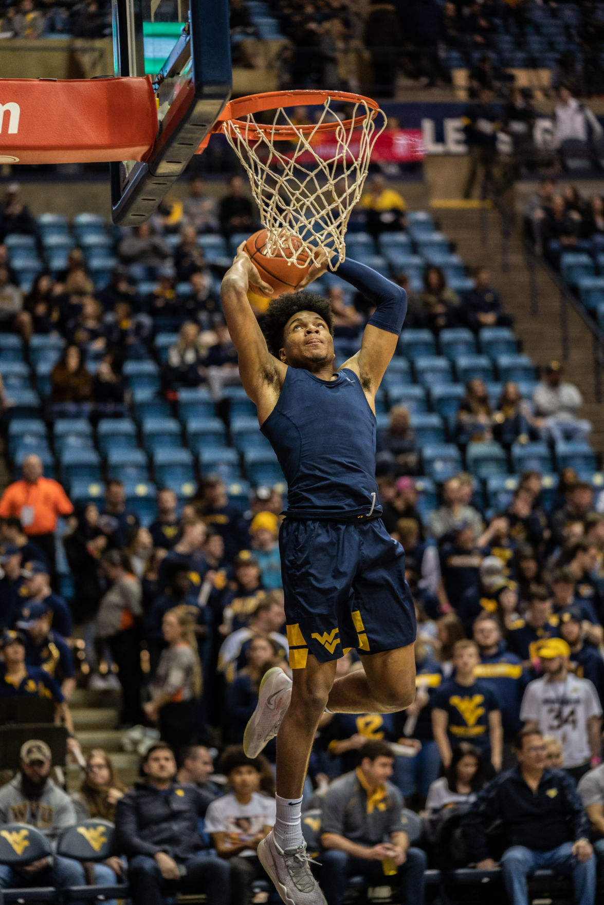 Miles McBride goes up for a dunk during warm ups before taking on Kansas State at the WVU Coliseum on Feb. 1, 2020.