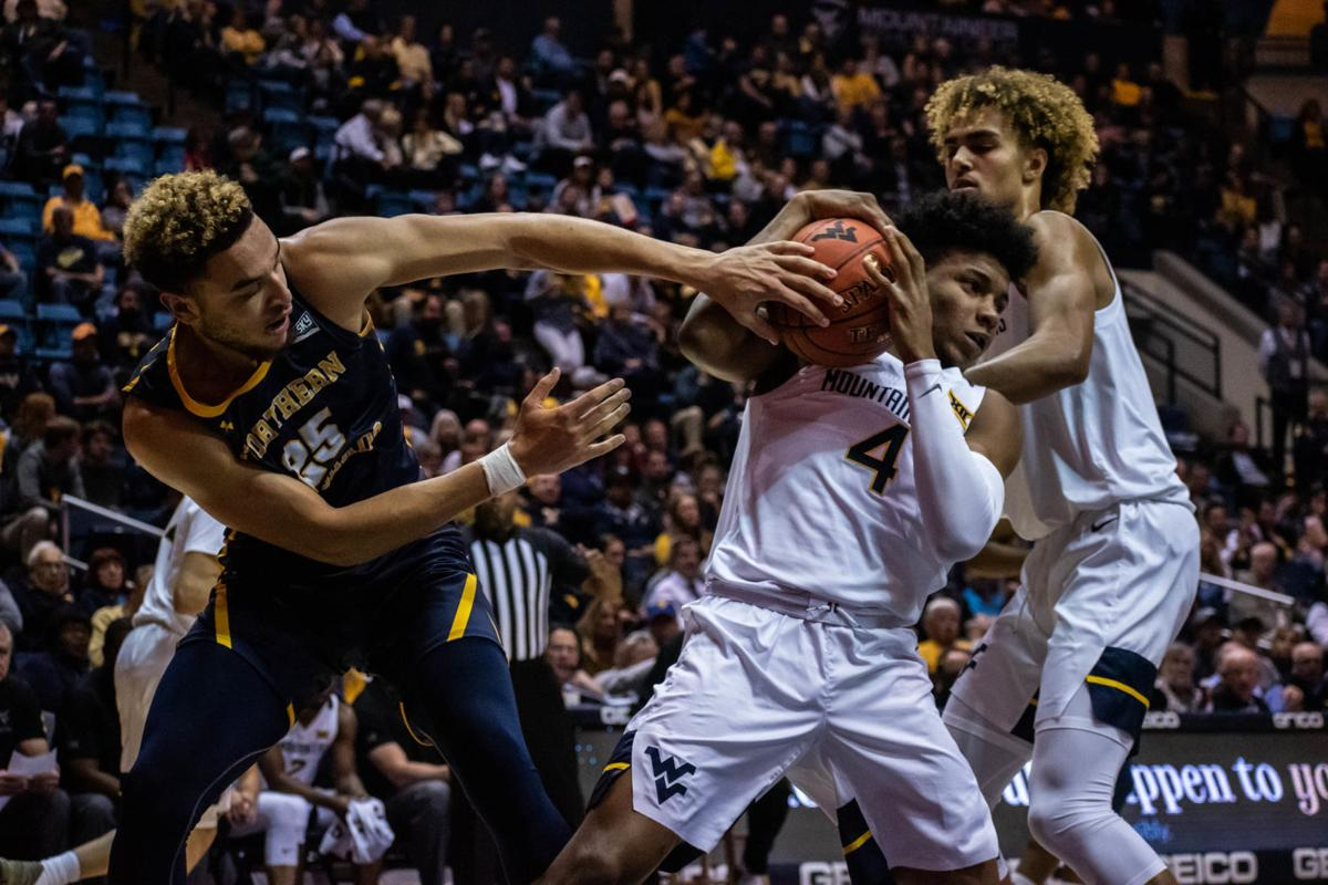 WVU's Miles McBride and Northern Colorado's Kai Edwards battle for the ball on Nov. 18, 2019 at the WVU Coliseum.