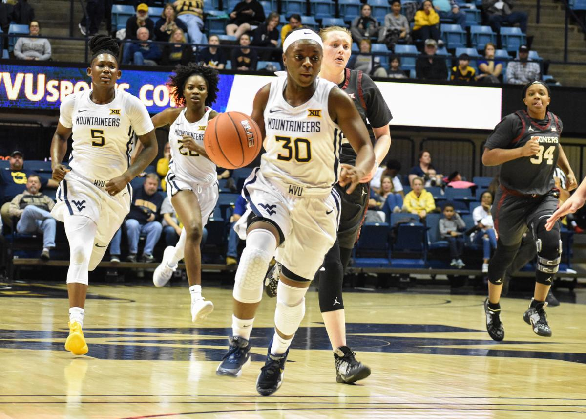 Jan. 15, 2020 - Sophomore Guard Madisen Smith pushes the ball down the court when facing off against Oklahoma at the Coliseum