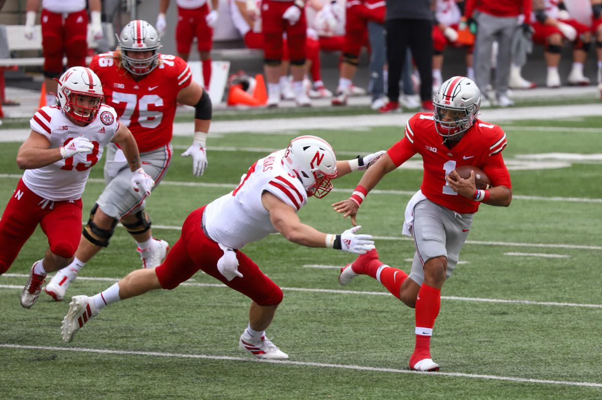 Ohio State quarterback (1) Justin Fields breaks away from a Nebraska tackler during the Ohio State game on Oct. 24, 2020 in Columbus, Ohio.