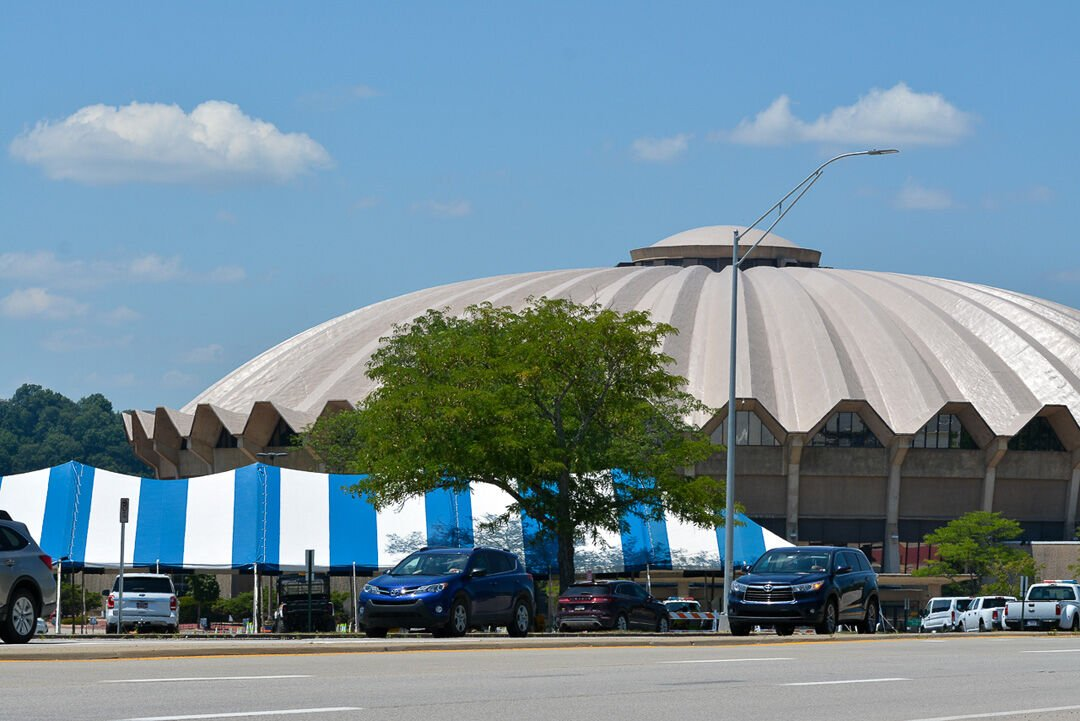 Jul. 18, 2020 - Blue and white striped tents are set up outside the WVU Coliseum in Morgantown for COVID-19 testing.