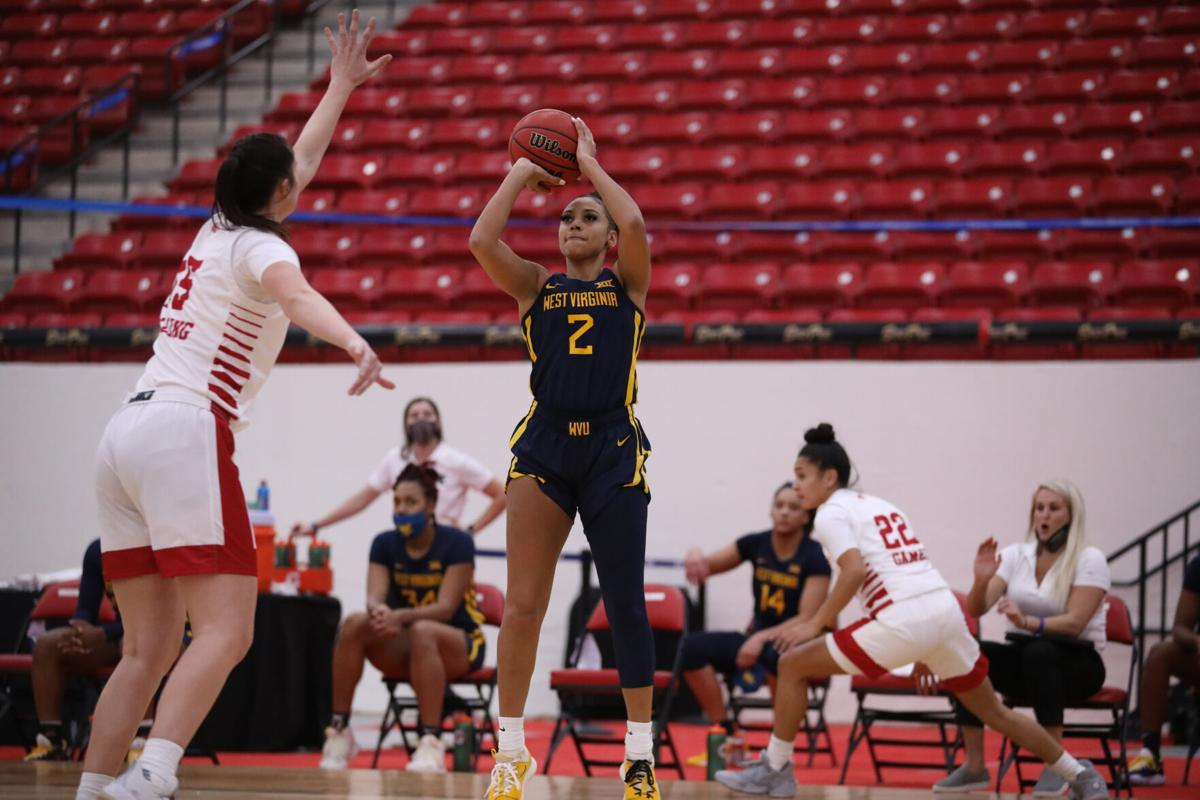 West Virginia guard Kysre Gondrezick (2) pulls up for a jump shot against Fresno State in the South Point Thanksgiving Shootout in Las Vegas, Nevada on Nov. 27, 2020.