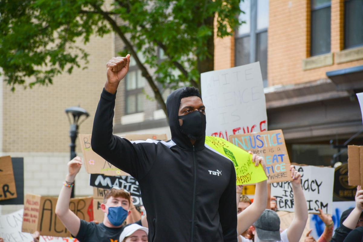 Jun. 2, 2020 - Former WVU basketball player John Flowers holds up his fist during the protests in downtown Morgantown.