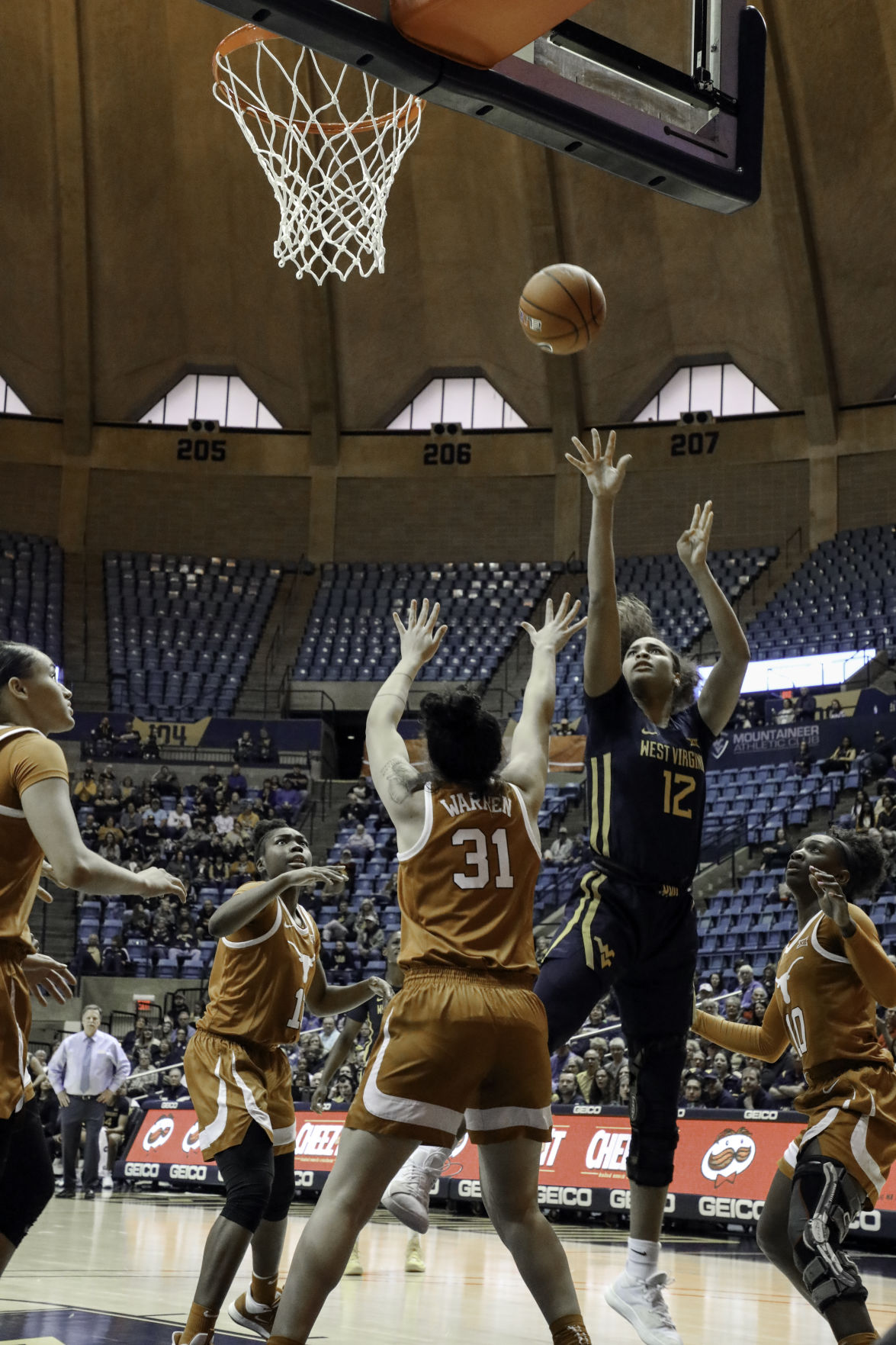 West Virginia forward Esmery Martinez goes up for a layup against Texas at the WVU Coliseum on Jan. 12, 2020.