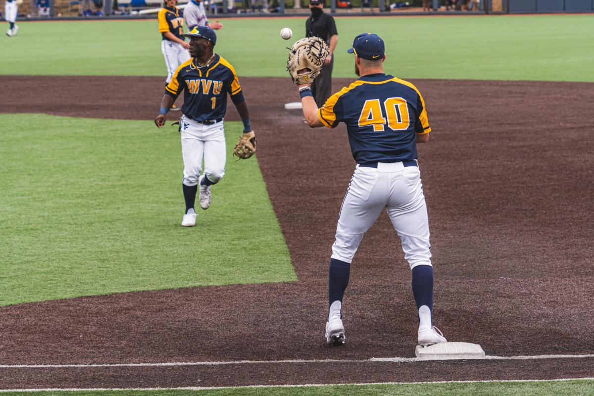 West Virginia first baseman Hudson Byorick makes the catch at first base against Kansas on March 27, 2021, in Morgantown.