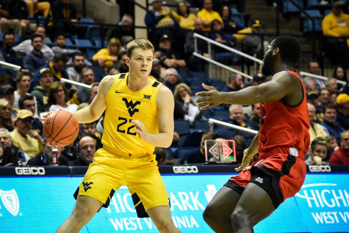 West Virginia guard Sean McNeil looks down the court for an open teammate against Austin Peay on Dec. 12, 2019 at the WVU Coliseum.
