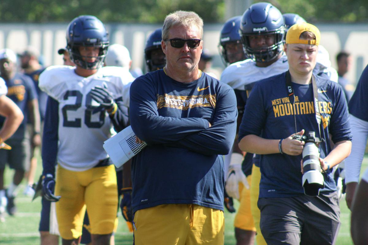 West Virginia defensive coordinator Vic Koenning looks on during practice.