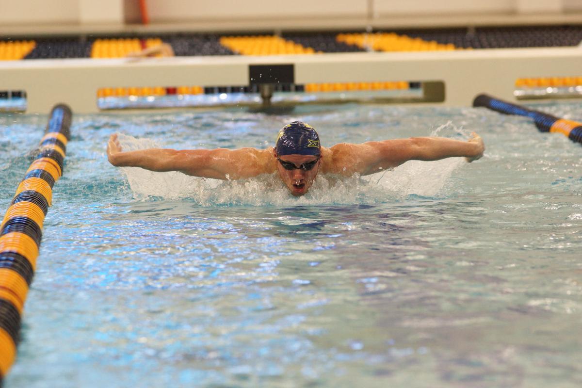 WVU's Jack Frazier swims against George Washington on Feb. 1.