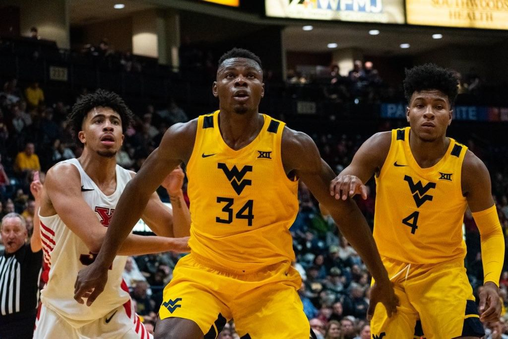 West Virginia forward Oscar Tshiebwe (34) boxes out a Youngstown State defender at the Covelli Centre on Dec. 21, 2019.