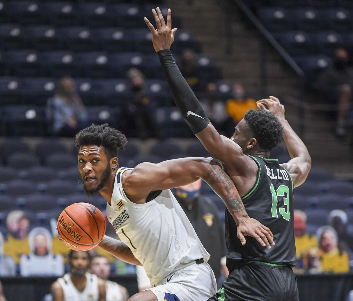 West Virginia forward Derek Culver drives in on a North Texas defender in West Virginia's 62-50 win over the Mean Green at the WVU Coliseum in Morgantown, W.Va., on Dec. 11, 2020.