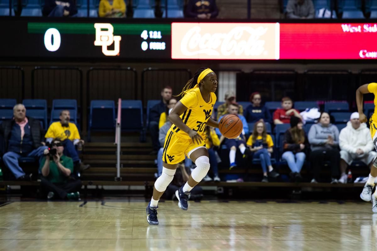 Feb. 24, 2020. WVU Coliseum. WVU guard Madisen Smith dribbles up the court during a game vs Baylor.